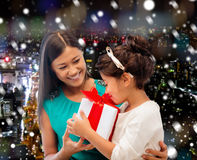 Happy mother and little girl with gift box Stock Image