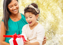 Happy mother and little girl with gift box Stock Photography