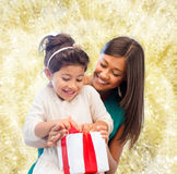 Happy mother and little girl with gift box Royalty Free Stock Photography