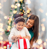 Happy mother and little girl with gift box Royalty Free Stock Image