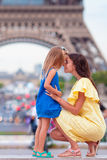 Happy mother and little girl in Paris near Eiffel Tower Stock Images