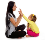 Happy mother and little girl playing isolated Royalty Free Stock Photography