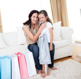 Happy mother and little girl after shopping Royalty Free Stock Photos