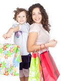 Happy mother and little girl with shopping bags Royalty Free Stock Photos