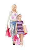 Happy mother and little girl with shopping bags Stock Photos