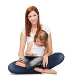 Happy mother with little girl and tablet pc Stock Images
