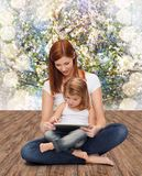 Happy mother with little girl and tablet pc Royalty Free Stock Photography