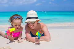 Happy mother and little girl at tropical beach Royalty Free Stock Photography