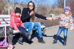 Happy mother and little girls enjoy sunny day in Royalty Free Stock Photography