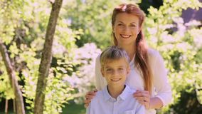 Happy mother and little son outdoors stock video footage