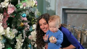 Happy mother and little son playing in home on Christmas holidays. Happy family mother and baby little son playing home on Christmas holidays. New Year`s stock video