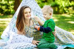 Happy mother and little son playing in the park. Bubbles. The co. Ncept of lifestyle and childhood Stock Photography