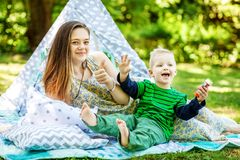 Happy mother and little son playing in the park. The concept of. Lifestyle and childhood Stock Photo