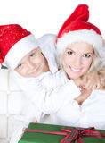 Happy mother with little son in santa helper hat Royalty Free Stock Images