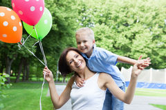 Happy mother and little son Stock Photos