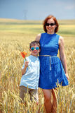 Happy mother with little son walking happily in Stock Photography