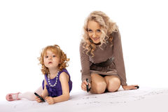 Happy mother look at daughter draw and smile Stock Photography