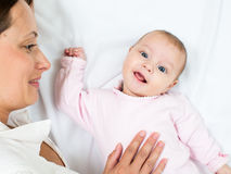 Happy mother looking at her baby girl infant Stock Photo