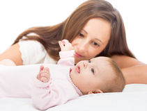 Happy mother looking at her baby infant girl Royalty Free Stock Photo