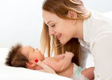 Happy mother looking at newborn baby stock images