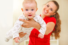 Happy mother and lovely baby playing on divan Royalty Free Stock Photography