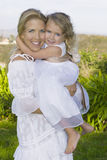 Happy Mother Lovingly Holds Daughter Stock Photography