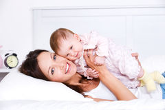 Happy mother lying with baby Royalty Free Stock Photography