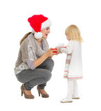 Happy mother making Christmas present to baby girl Stock Photography