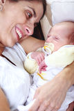Happy mother with newborn baby Stock Photos
