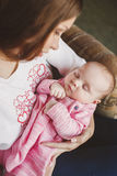 Happy mother with newborn baby girl in her arms. Royalty Free Stock Photography