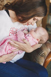Happy mother with newborn baby girl in her arms. Royalty Free Stock Photo
