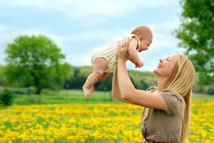 Happy Mother and Newborn Baby Girl Playing Outside Stock Photos