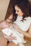 Happy mother with newborn baby Stock Photos