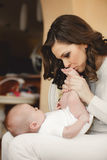 Happy mother with newborn baby Stock Images
