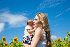 Happy mother and newborn child Royalty Free Stock Images