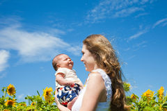 Happy mother and newborn child Royalty Free Stock Photos