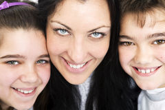 Happy mother with offsprings. Happy mother smiling with offsprings Stock Image