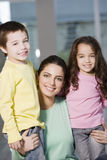 Happy mother and offsprings. Smiling Royalty Free Stock Photos