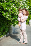 Happy mother outdoors Royalty Free Stock Images