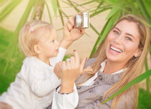 Happy mother photographing baby Royalty Free Stock Image