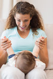 Happy mother playing with baby Stock Images