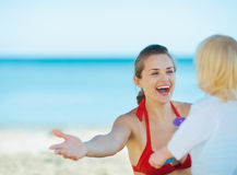 Happy mother playing with baby girl on beach Stock Photography