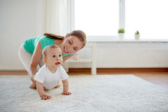 Happy mother playing with baby at home Royalty Free Stock Photo
