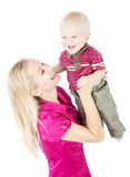 Happy mother playing with child raising up royalty free stock image