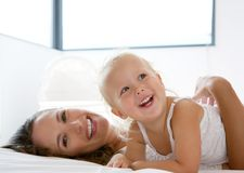 Happy mother playing with cute little girl Stock Images