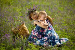 Happy mother playing with daughter in field. Outdoor shot Royalty Free Stock Photos