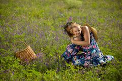 Happy mother playing with daughter in field. Outdoor shot Stock Photo