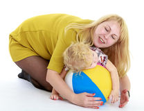 Happy mother playing with her adorable little girl Stock Image