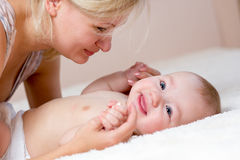 Happy mother playing with her baby boy Stock Photography