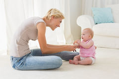 Happy mother playing with her baby girl Royalty Free Stock Photo
